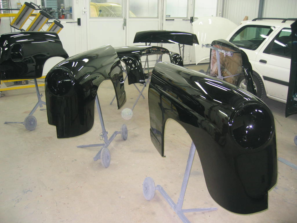 Shiny, freshly painted Ponton parts; doors, fenders, trunk lid and hood