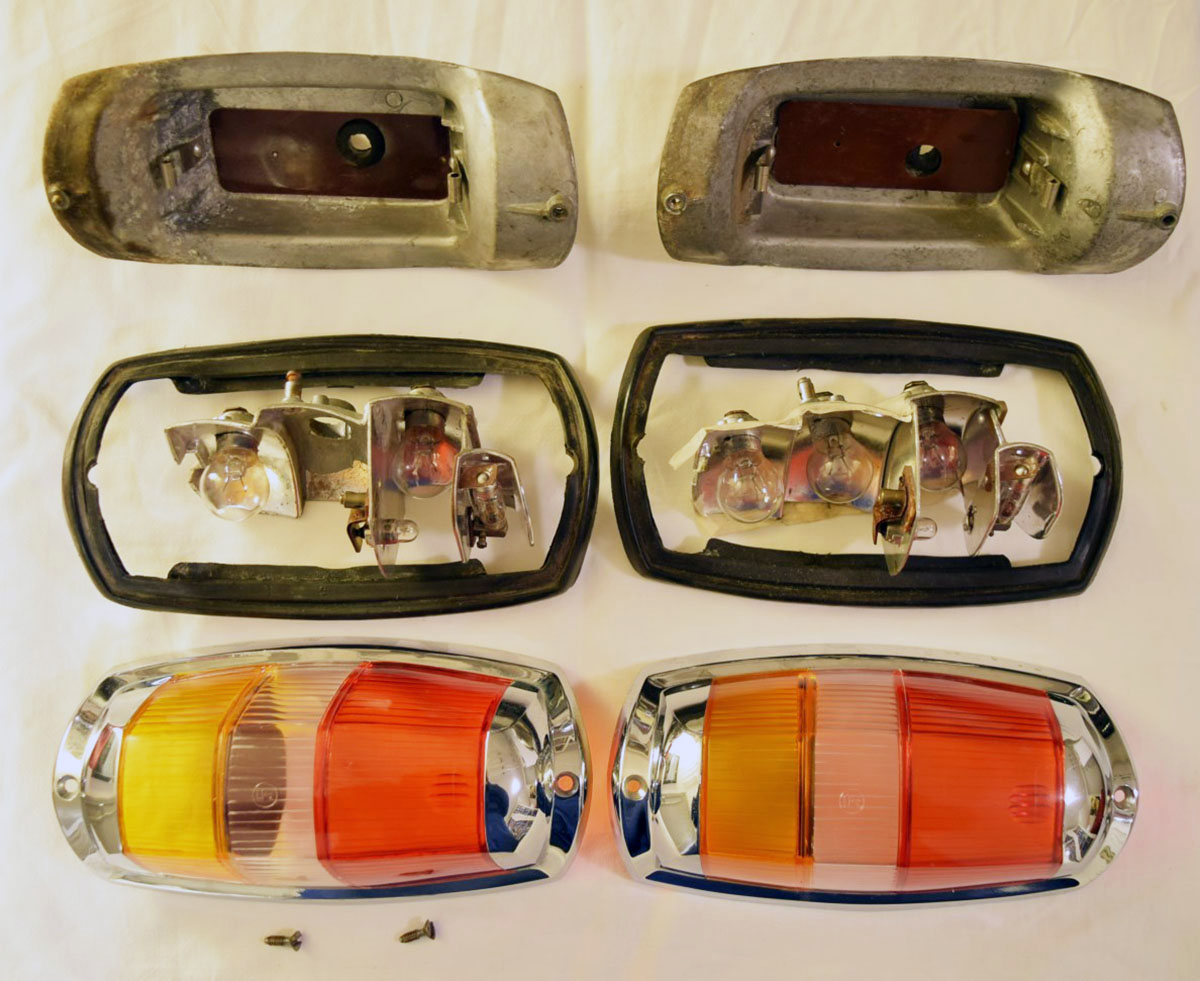 A pair of complete, unrestored stop and tail lights for a Mercedes-Benz Ponton type 219 W105 1957